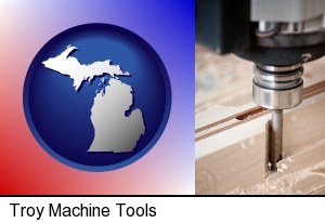 a CNC milling machine cutting wood in Troy, MI