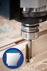 arkansas map icon and a CNC milling machine cutting wood