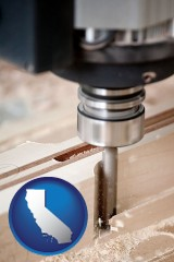 california map icon and a CNC milling machine cutting wood