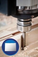 colorado map icon and a CNC milling machine cutting wood