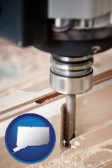 connecticut map icon and a CNC milling machine cutting wood
