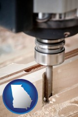 georgia map icon and a CNC milling machine cutting wood