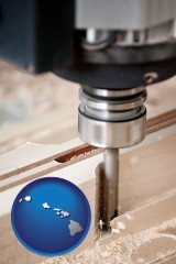 hawaii map icon and a CNC milling machine cutting wood