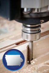 iowa a CNC milling machine cutting wood