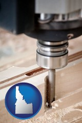 idaho map icon and a CNC milling machine cutting wood
