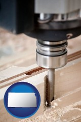 kansas a CNC milling machine cutting wood