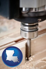 louisiana map icon and a CNC milling machine cutting wood