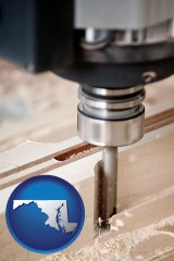 maryland map icon and a CNC milling machine cutting wood