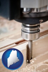 maine map icon and a CNC milling machine cutting wood