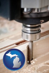michigan map icon and a CNC milling machine cutting wood