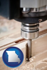 missouri map icon and a CNC milling machine cutting wood