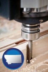 montana map icon and a CNC milling machine cutting wood