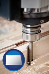north-dakota map icon and a CNC milling machine cutting wood