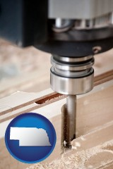 nebraska map icon and a CNC milling machine cutting wood