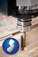 new-jersey map icon and a CNC milling machine cutting wood