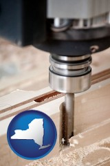 new-york map icon and a CNC milling machine cutting wood