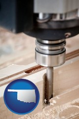 oklahoma map icon and a CNC milling machine cutting wood