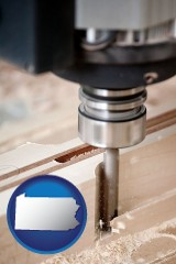 pennsylvania map icon and a CNC milling machine cutting wood