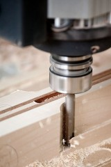 a CNC milling machine cutting wood