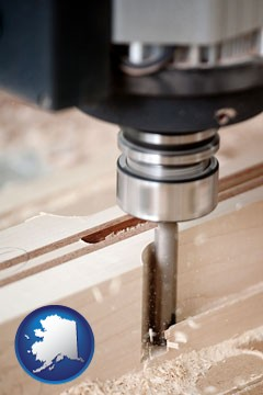 a CNC milling machine cutting wood - with Alaska icon