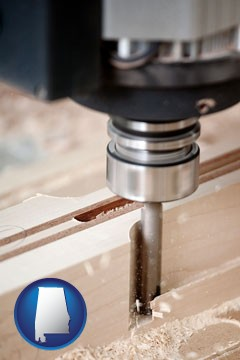 a CNC milling machine cutting wood - with Alabama icon