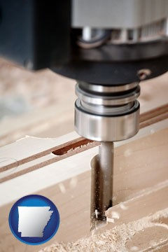 a CNC milling machine cutting wood - with Arkansas icon
