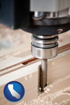 a CNC milling machine cutting wood - with California icon