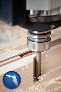a CNC milling machine cutting wood - with Florida icon