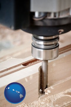 a CNC milling machine cutting wood - with Hawaii icon