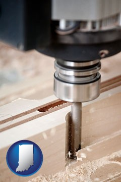 a CNC milling machine cutting wood - with Indiana icon