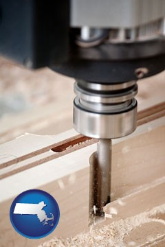 a CNC milling machine cutting wood - with Massachusetts icon