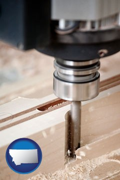 a CNC milling machine cutting wood - with Montana icon