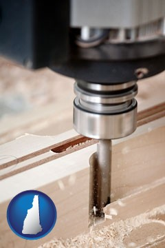a CNC milling machine cutting wood - with New Hampshire icon