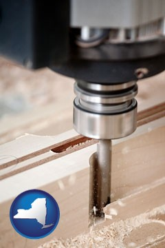 a CNC milling machine cutting wood - with New York icon