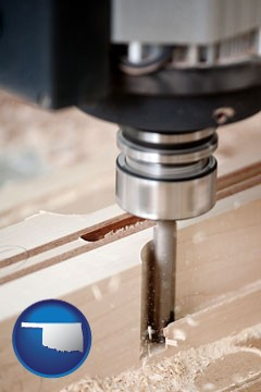 a CNC milling machine cutting wood - with Oklahoma icon