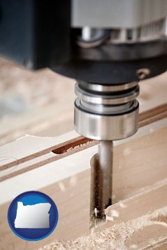 a CNC milling machine cutting wood - with Oregon icon
