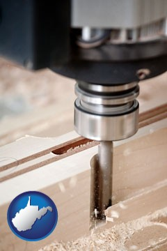 a CNC milling machine cutting wood - with West Virginia icon